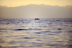 Fisherman on Ohrid Lake at sunset Stock Images