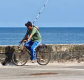 Fisherman On Bicycle In Cuba Stock Image
