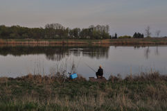 Free Fisherman On The Quiet Evening On The River Tisa Royalty Free Stock Photography - 96410007