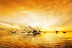 Fisherman in orange morning Stock Images