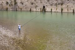 Fisherman on the Osum River in the historic city of Berat, Albania. stock photography