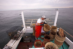 A fisherman out at sea Stock Photos