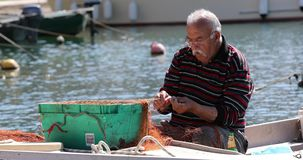 Fisherman patches fishing stock footage