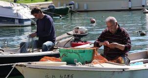 Fisherman patches fishing