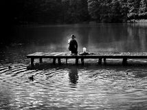 Fisherman on pier Royalty Free Stock Photo