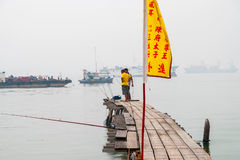 Fisherman on the pier in George town Royalty Free Stock Image