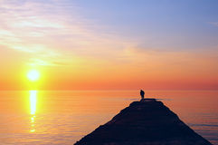 Fisherman on a pier, Golden Dawn Royalty Free Stock Photography