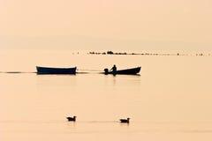 Fisherman in a pleasure boat Stock Photo