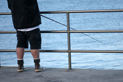 Fisherman and Pole. Royalty Free Stock Photo