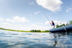 Fisherman on the pond Royalty Free Stock Photography