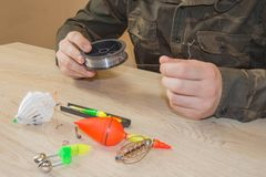 Fisherman prepare to fishing. Fishing tackle - fishing spinning, hooks and lures stock photos