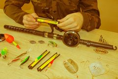 Fisherman prepare to fishing. Tools and accessories on wooden table royalty free stock photos