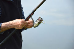 Fisherman prepares fishing rod Stock Photo