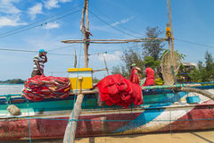 Fisherman preparing fishing net on a boat Royalty Free Stock Photos