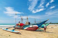 Fisherman preparing fishing net on a boat Stock Images