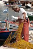 Fisherman preparing fishing net Stock Images
