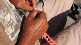 Fisherman. Preparing lead on gout stock video footage