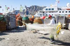 Greenlandic fisherman preparing nets Royalty Free Stock Images