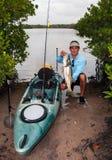 Fisherman. A proud fisherman showing his trophy Stock Photo