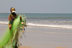 Fisherman pulling a fishing net Royalty Free Stock Photos