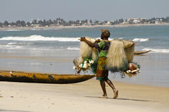 Fisherman pulling a fishing net. On madagascar beach royalty free stock photography