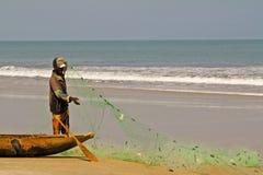 Fisherman pulling a fishing net Stock Photo