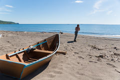 Fisherman pulls a heavy wooden boat Royalty Free Stock Image