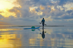 Fisherman pulls kayak Royalty Free Stock Photo