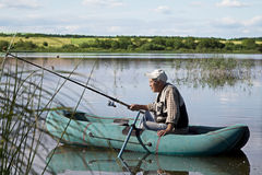 Fisherman on a quiet lake Stock Images