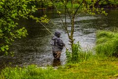 Fisherman in the rain Stock Photography