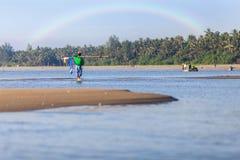 Fisherman on rainbow background. Selective focus Stock Image
