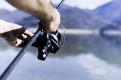 Fisherman. Relaxes with fishing rod Stock Photography