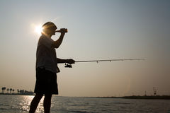 Fisherman relaxing at sunset Royalty Free Stock Photography