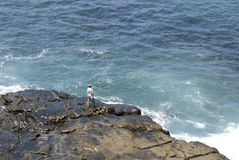 Fisherman on remore reef Royalty Free Stock Images