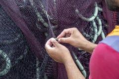 Free Fisherman Repairing Fishing Nets 2 Royalty Free Stock Photo - 160935865