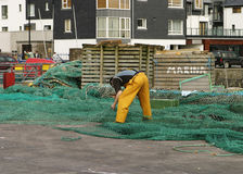 Fisherman Repairing Nets Royalty Free Stock Images