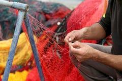 Fisherman Repairs Fishing Net. Closeup View Stock Images