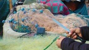 Fisherman Repairs Fishnet stock video