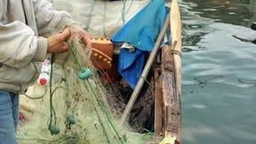 Fisherman Repairs Fishnets stock video footage