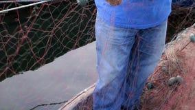 Fisherman repairs fishnets. Fishing Lines stock footage