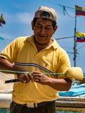 Fisherman repairs his net Royalty Free Stock Images