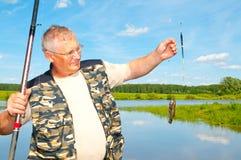 Fisherman on river. Angler, angling royalty free stock photo