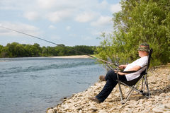 Fisherman in the river Stock Image