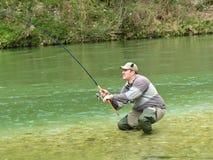 Fisherman on river Royalty Free Stock Image