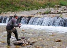 Fisherman on river Stock Image