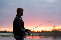 Fisherman on the river bank Stock Photography