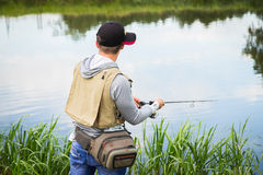Fisherman on the river bank Royalty Free Stock Images
