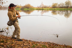 Fisherman on the river bank Royalty Free Stock Photo