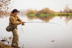 Fisherman on the river bank Stock Image