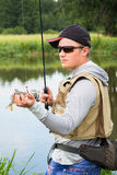 Fisherman on the river bank Stock Photo